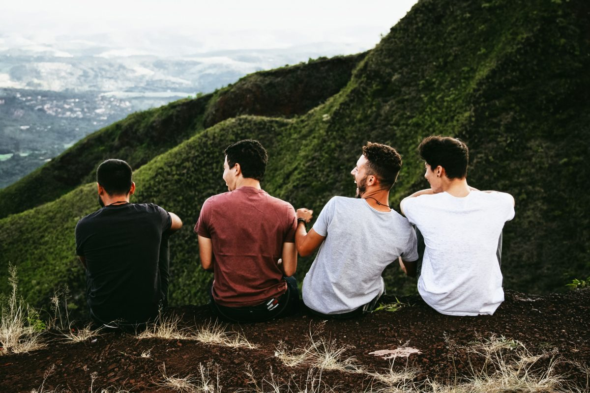Four guys sat laughing together.