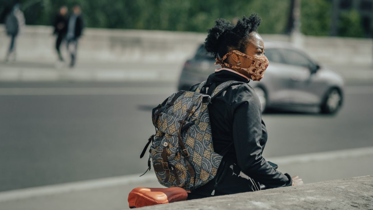 person, backpack, cyling, road, mask on face